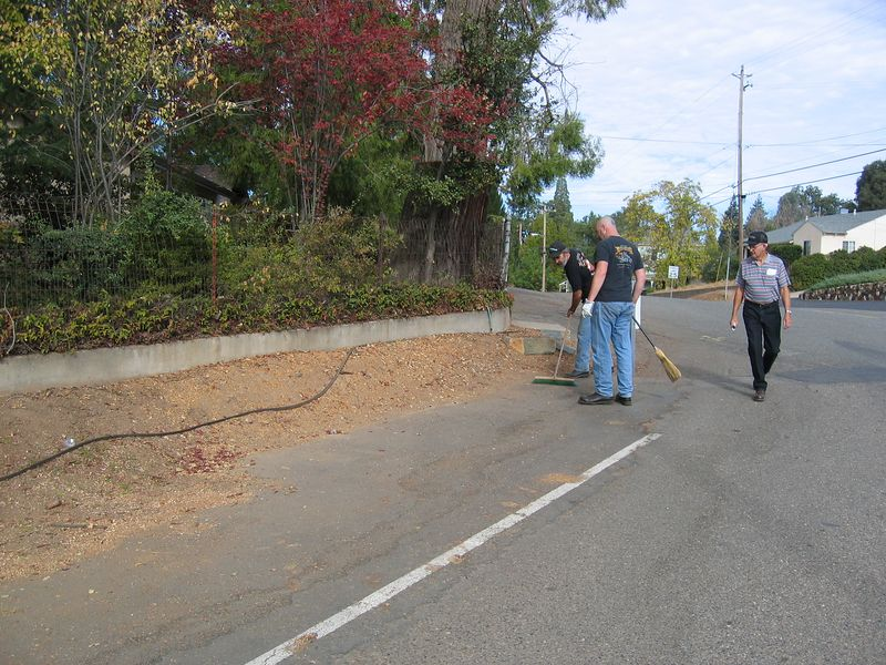 Victorville Lou and Tusk cleaning the parking area (and neighbor on a walk)