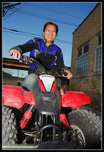 OMG she is so cute. Posing on LJ's Suzuki 50cc Quad