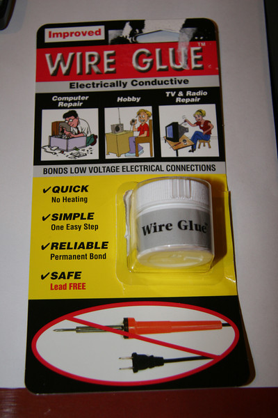 "This was the missing link. The company's own website with info is at  <a href=""http://wireglue.us"">http://wireglue.us</a>, but they do not sell it direct. I bought it from Edmund Scientific, who shipped it the next day or very reasonable cost. It is possible to make your own conductive glue with DAP contact cement and graphite, but I had neither."