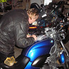 Doing the paperwork to document the miles on Ray's R1200C.