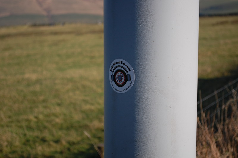 Sidestand Up.com stickers on the camera pole. Cat and Fiddle.
