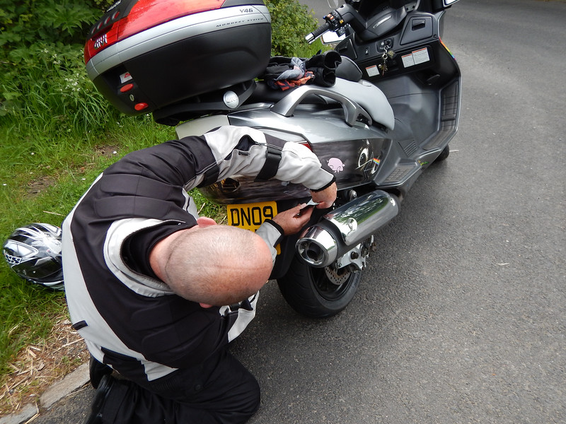Andy's Bodywork falling off near Donnington. This was not his only Technical issue on the trip