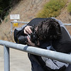 Beth shooting the dam with my ancient Nikon. It uses film.