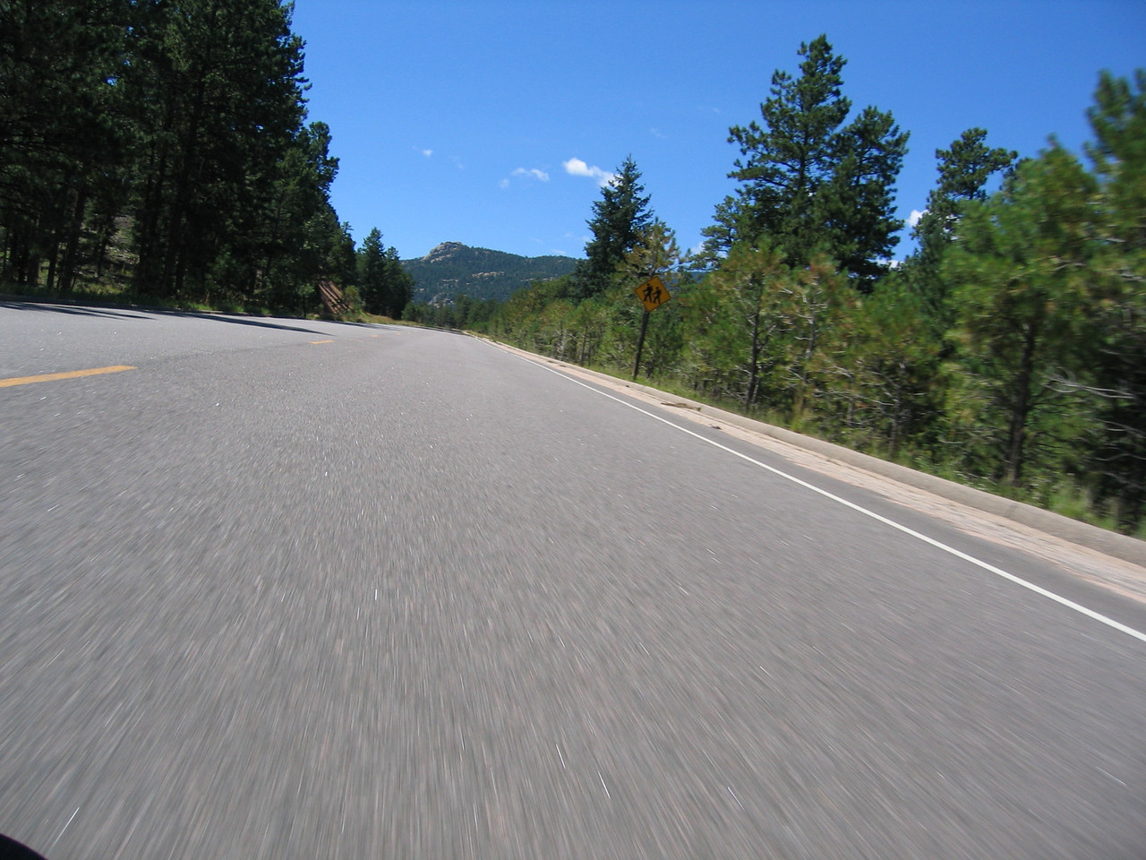 Leaving Breckenridge, we head for the next pass:  Hoosier Pass.  During our ascent, we encounter some traffic, so I end up making a few passes on the double yellow, eventually cutting off a mini-van as I encounter a large pickup heading straight for me.  I don't feel bad, as the mini-van had plenty of opportunity to use a pull-out and let the vehicles behind it pass by safely.