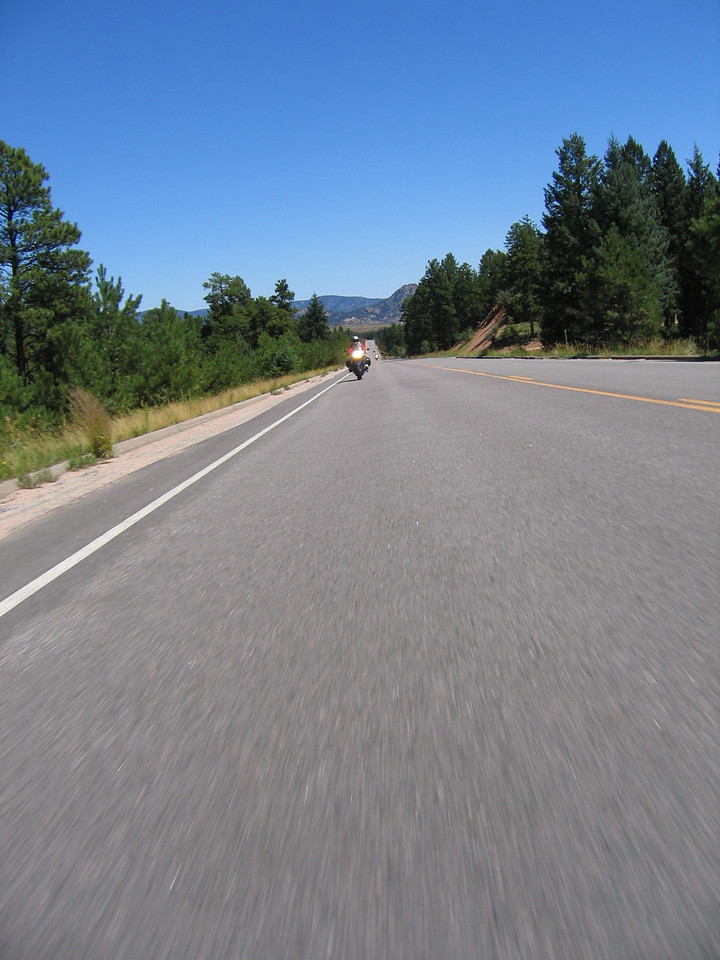 After Hoosier Pass, we continue on to Fairplay and turn eastbound on 285 and head over Red Hill Pass and Kenosha Pass, which frame the wide mountain valley of South Park.  We encounter some traffic on 285, and begin working our way through the cars.  Eventually we get through the traffic, and wick up the bikes as we get to open road.  Tripple digits were allegedly noted on the speedometers.<br /> <br /> We continue to Bailey, where we stop for fuel.  While fueling up, I recognize Jeff (CA1200) and his K1200GT parked at the Conoco convenience store.  We chat for a bit, and he joins our little group.