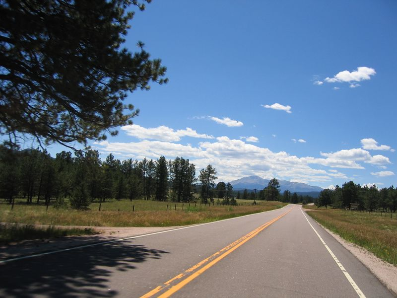 Time to enjoy the scenery.   This photo was taken as we head for Woodland Park on Highway 67.  Pikes Peak looms in the background.
