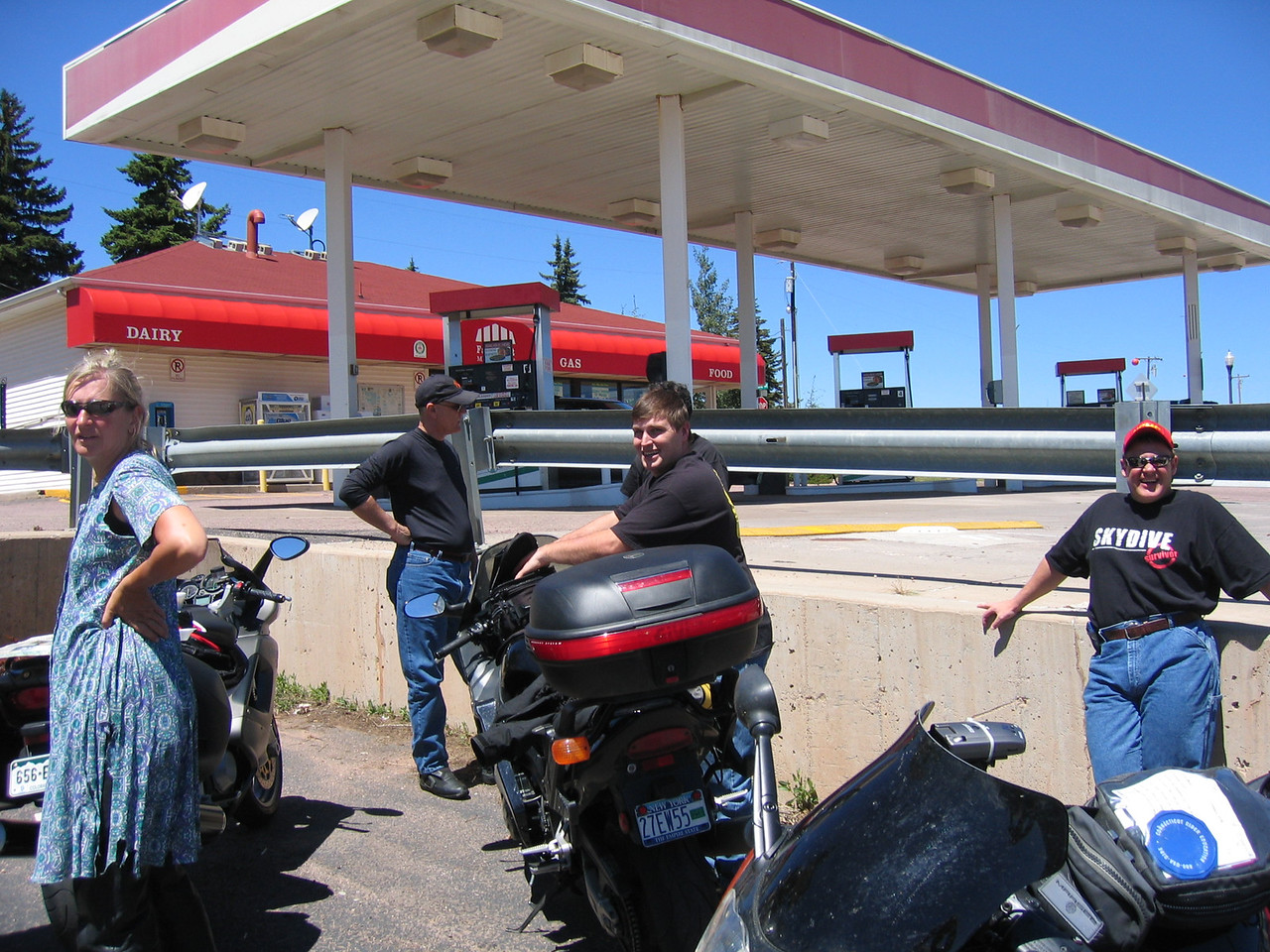 Here we find the Sport-Touring.NET group resting after a well earned meal.  From left to right:  Carolina?, Dave?, Justin, Bikerfish (hidden behind Justin), and Tabasco.  Sfarson's Ducati ST4s and Justin's Blackbird are also in the photo.