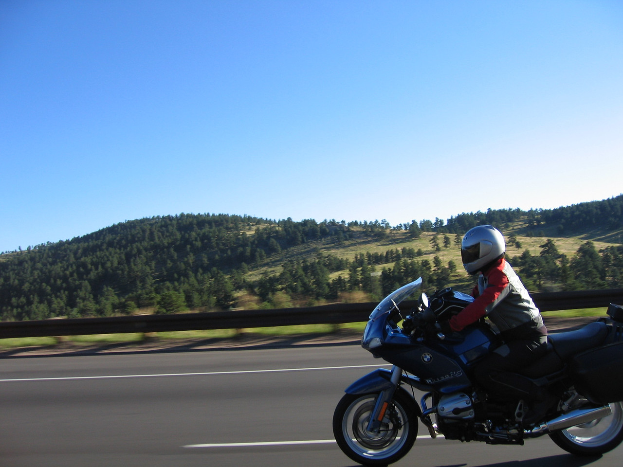 I was riding with a good friend, Liz Majors, who rides an R1150RS.  The route began with a ride up I-70 to the Evergreen exit, with the first pass being Squaw Peak pass.  Here's Liz at speed.