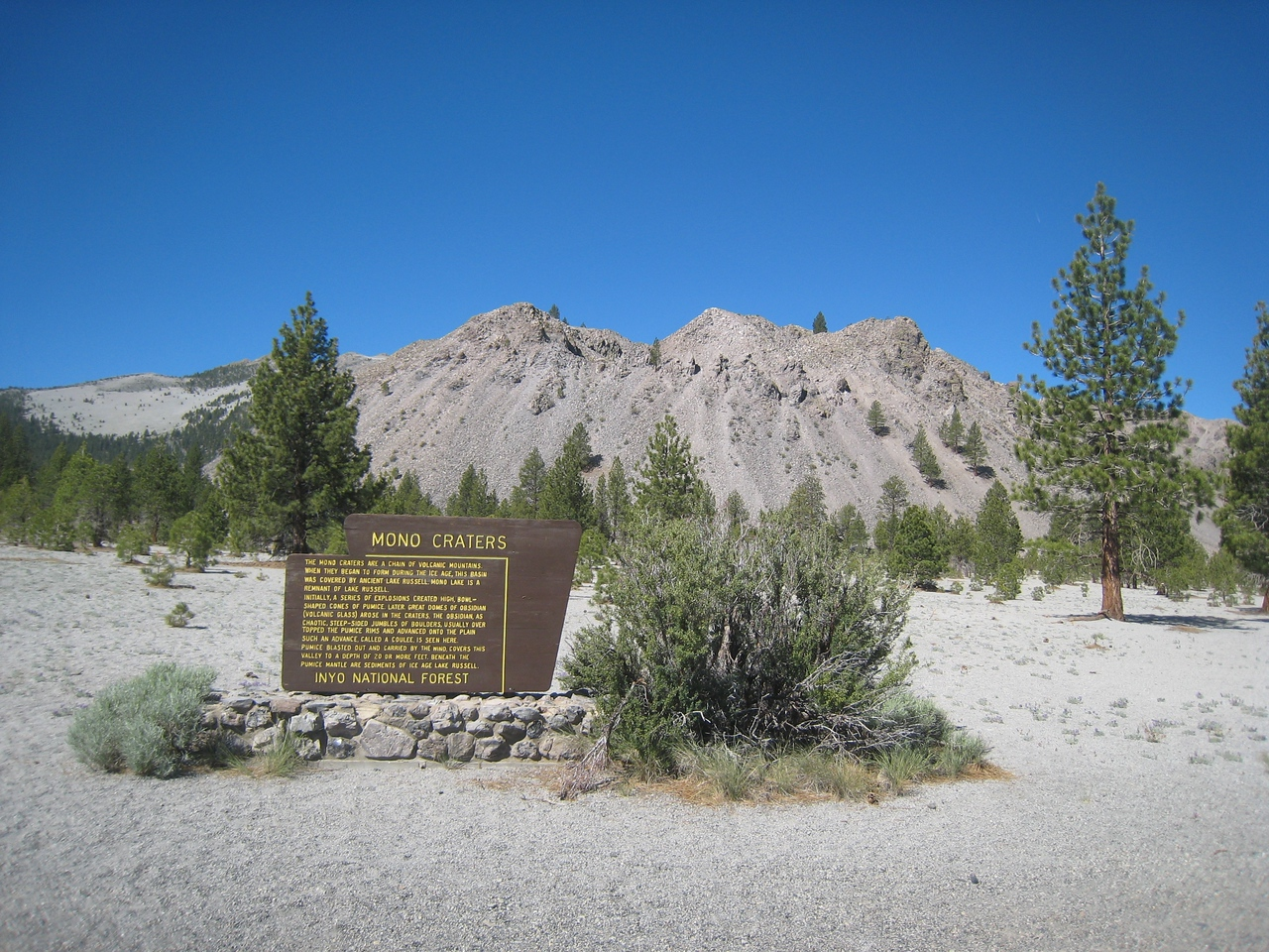 A view of the Mono Craters as described in the sign.