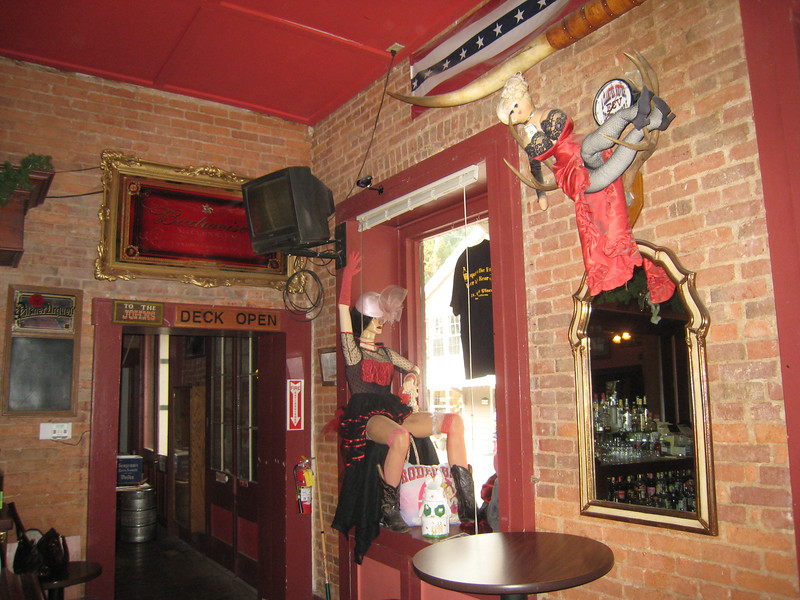 "The interior of the St. Charles Place saloon pays homage to the old west.  It reminds me of a restaurant in Paonia, CO, which has many antiques and memorabilia of the ""Soiled Dove"" variety."