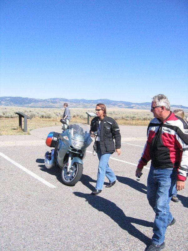 Liz Majors and Jim Sutton walk past my GT.