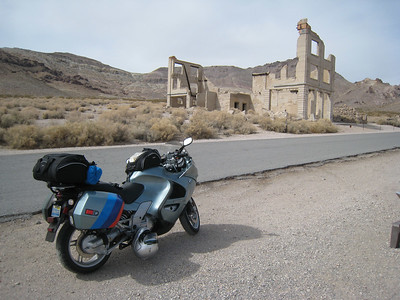 The town's bank.  Rhyolite is relatively new as ghost towns go.  Gold was discovered in 1904, and by 1906 the town was home to 10,000 people.  Then the gold veins went cold, and the town disappeared by 1908.  Many of the buildings had just been completed when the mines dried up, and were scarcely used when they were abandoned.