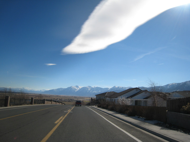 Approaching the neighborhood, I notice the long cloud above the valley, wondering if its a standing wave caused by winds whipping over the Sierra crest.
