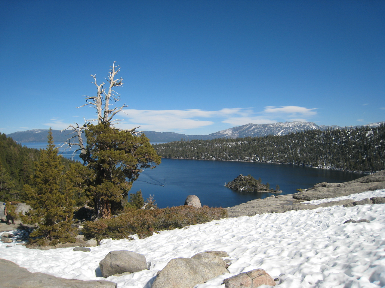 At the southwest corner of the lake, we find Emerald Bay.  I stop the bike and take a few snapshots at the viewing area.