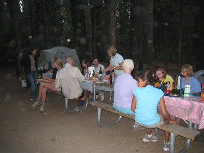 The dinner is a white linen affair by camping standards, complete with candles, wine, and plasticware.