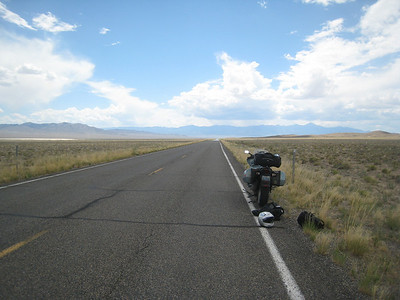 I look to the west, the direction I should be travelling... not a sign of humanity other than the road.