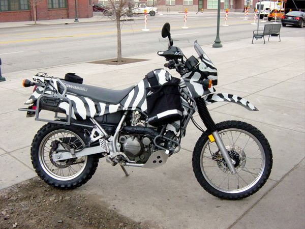 Morning start at the Monkey Bean, Denver. KLR ready to go...almost...loose battery connection results in slight delay.