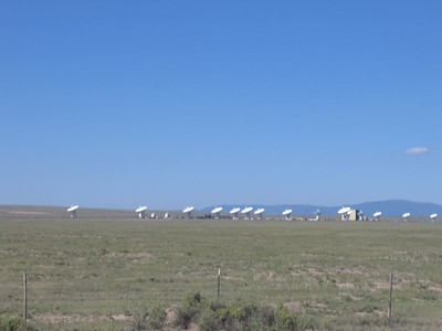 (Click on image to enlarge)  The Very Large Array (VLA) is a radio-telescope system.  You've probably seen this on TV or in a movie or two.  It is a huge radio telescope that is comprised of a series of smaller antennas that work together to function as a single huge antenna.