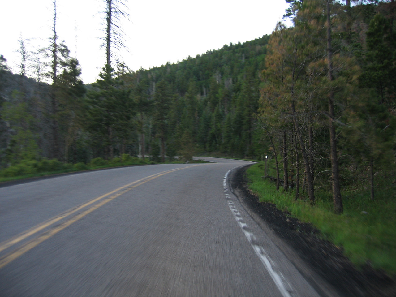 (Click on image to enlarge)<br /> <br /> Leaving Los Alamos, I quickly encounter some really tight twisties, passing other riders coming the other way.  They must think I'm nuts as I'm just starting the ride at dusk.  The road is called the Jemez Trail, and it is worth the trip.