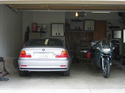 (Click on image to enlarge)  Motorcycle ready to go, parked next to it's brother Bimmer.  Of course, some very bad weather is moving in as I try to leave, forcing me to change my plans and reverse the route.  The weather is worse out west, so I decide to head south to New Mexico, then west to Phoenix.  Unfortunately, I miss my weather window, and get caught in a terrible hail / lighting / torrential downpour as I get to the Denver Tech Center.  Stupidly I continue on.  Breaking through the weather as I reach Monument, the traffic speeds pick up, until I reach a complete stop due to an accident in Colorado Springs.  Not a good way to start the trip >:(