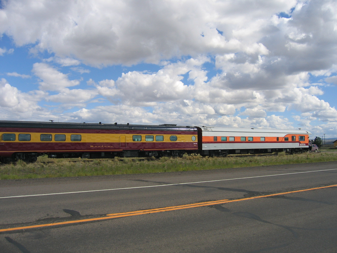 (Click on image to enlarge)<br /> <br /> Old passenger cars rest near the road.