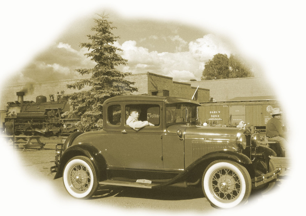 (Click on image to enlarge)<br /> <br /> Exercising my Photoshop skills.  This old Ford was parked in the station.  I gave it a sepia effect, blurred, and added noise to degrade the film to replicate an old camera, and added a vignette.  I think it turned out nicely.