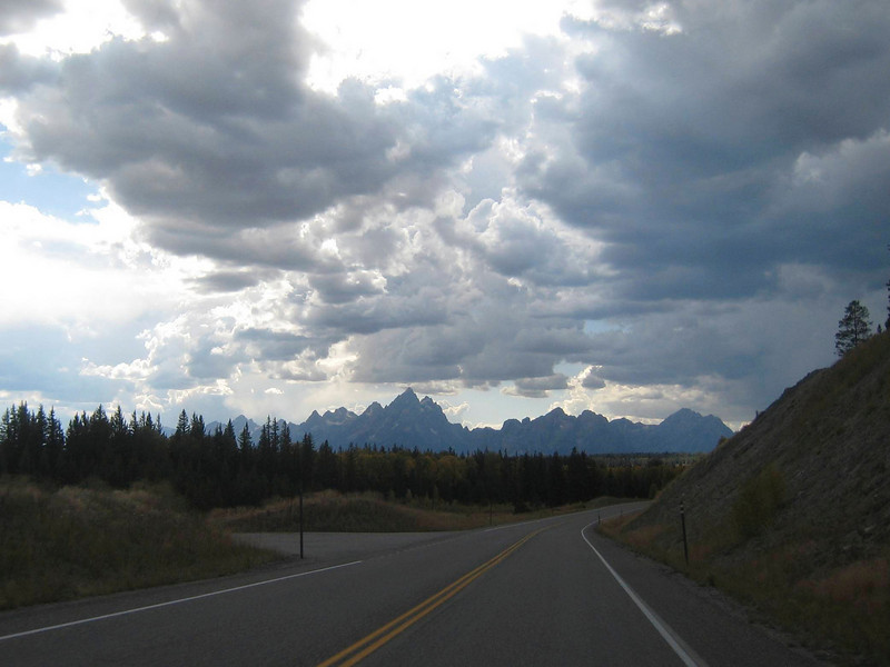 "As I approach the Grand Tetons, I can see clouds gathering.  Its very common in the west to get afternoon thundershowers, and it looks like I'm in for a game of ""dodge the raincell."""