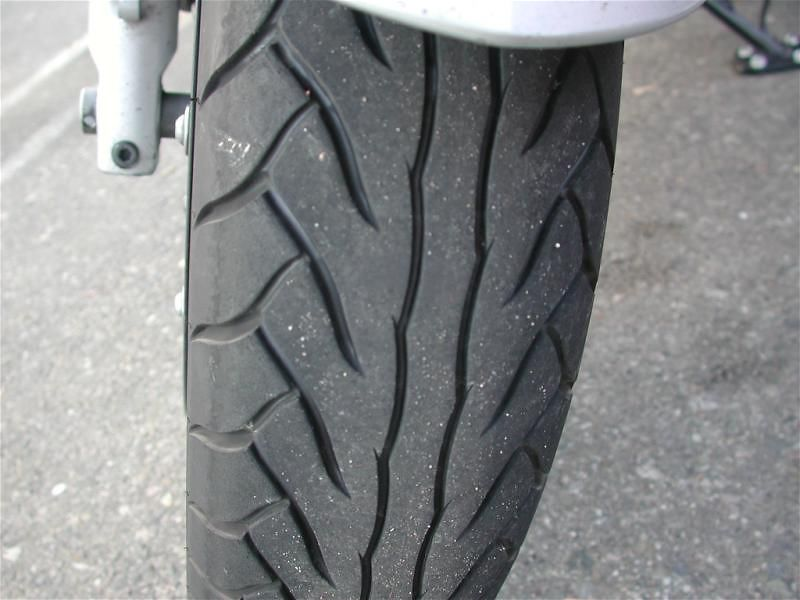 Horrible tire, that Dunlop D220...grabs raingrooves and other longitudinal anomolies in the roadbed