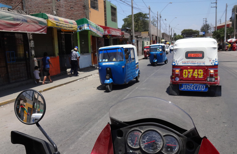 Dodging mototaxis.Ica, Peru