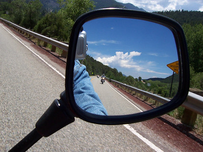 Caroline in the rear-view mirror on NM 76, north of Peñasco. We are on our way to the alpaca ranch in Mora.
