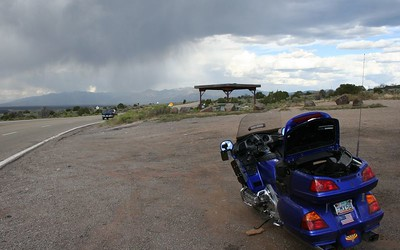 Coming into Taos; putting on the rain gear.