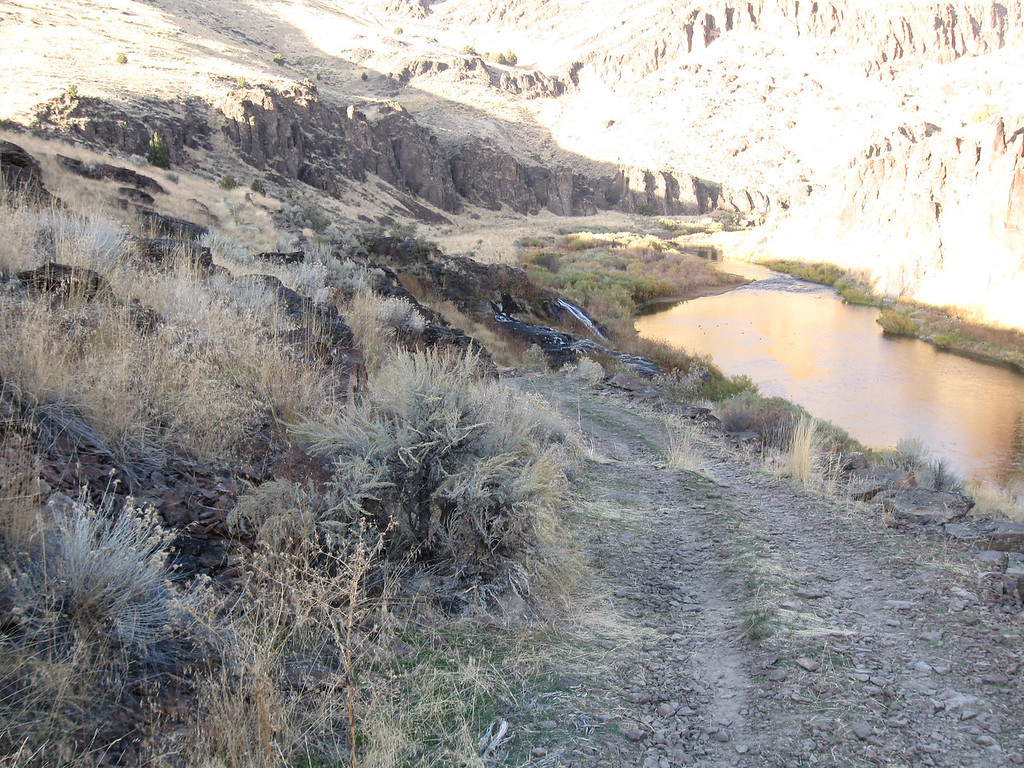 Near the hot spring creek.  See its waterfall ending at the Owyhee River.