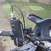 "COBRA radio on custom mount plate which is affixed to the clutch mounting bolts.  Normally the lanyard is wrapped around the mount plate as an additional security strap.  The sound is piped into my helmet using the cable in the foreground.  Note that my bike has 2"" risers (which I really, really like)."
