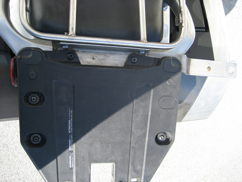 The metal bar attaches to the rear base plate for the top box. The extension to the right was designed for a CB antenna.
