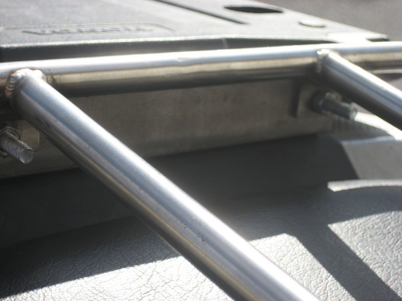 The two screws that attach the rear of the rack to the bar that attaches to the base plate.