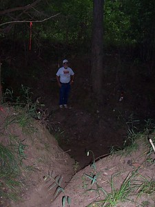 Looking down into the dry creek bed where Randy and Chris worked. It was still pretty dark in the woods this early in the morning.