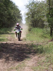 A racer comes up a long straight on day 1.
