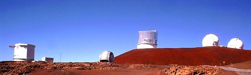 And here we see some of the reasons for the frequent visits to the summit of Mauna Kea. From the left --- The James-Clerk-Maxwell Telescope, The Submillimeter Array Building peeks out, the silvery dome of the Caltech Submillimeter Observatory, the flattop dome of the Subaru Telescope, and the twin domes of Keck Observatory.