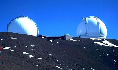 The twin domes of the Keck today. Some snow remains from the last snowfall.