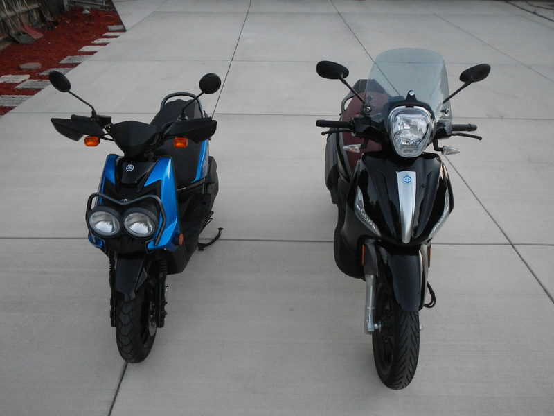 Cindy's Yamaha Zuma 125 on the left and my Piaggio BV350 on the left.
