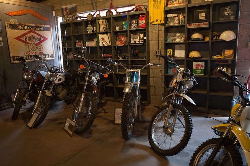 Looks like a garage full of old dirt bikes.