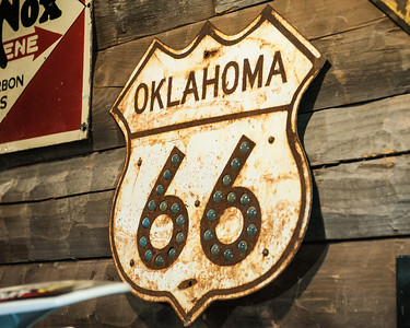 Old Route 66 sign with reflectors.