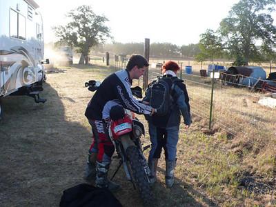 Shawn adjusts Nicole's pack
