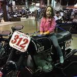 Keira riding Johnny Scheff's Vintage BMW Racebike