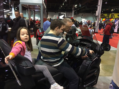 Keira on the Goldwing while Craig explains how to make espresso using the onboard machine