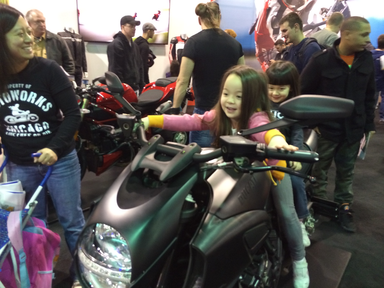 Keira giving Chloe a ride on the Diavel