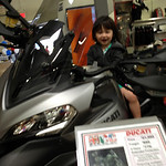 Chloe on the blurry multistrada