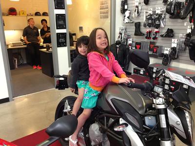 Two beautiful girls on one beautiful bike.