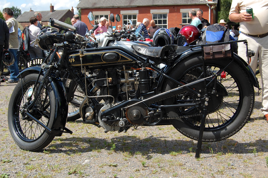 Vintage AJS with gas lights.