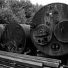 b&W old boilers rusting in rail yard